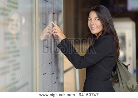 Woman Reading Train Timetable