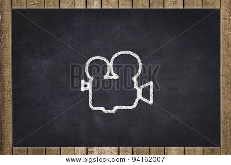 camera icon / drawing on black chalkboard