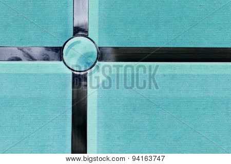 Abstract Metal Cross On The Green Background