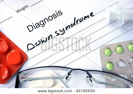 Diagnosis Down syndrome and tablets.