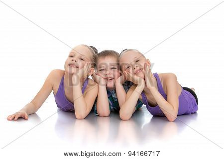 Beautiful girls gymnasts next to his younger brother