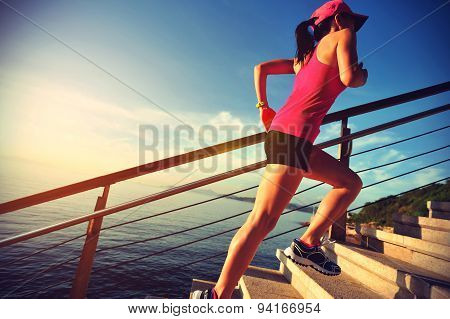 healthy lifestyle sports woman running up on stone stairs seaside,vintage effect