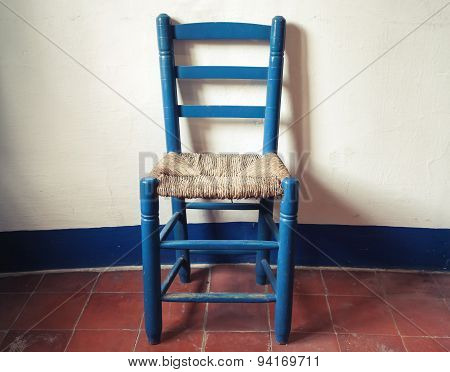 Old Blue Wooden Chair With Wicker Seat