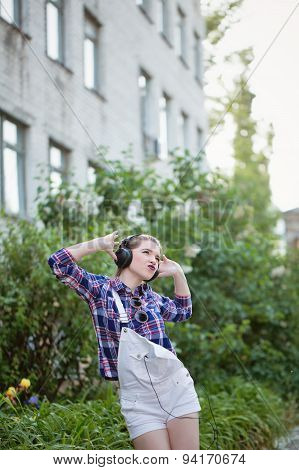 Hipster Girl Dancing To Music In Headphones.