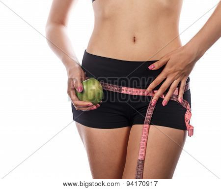 Girl Measures Buttocks And Holding Apple.