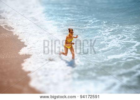 Woman running on the sea coast