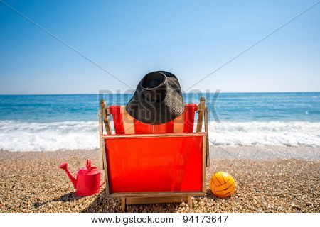 Woman in hat lying on the sunbed