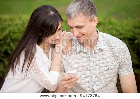 Couple Playing With Phone