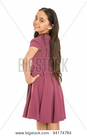 Portrait of beautiful dark-haired girl in a fashionable dress, close-up