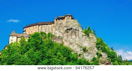Orava Castle, green trees with blue sky, Slovakia