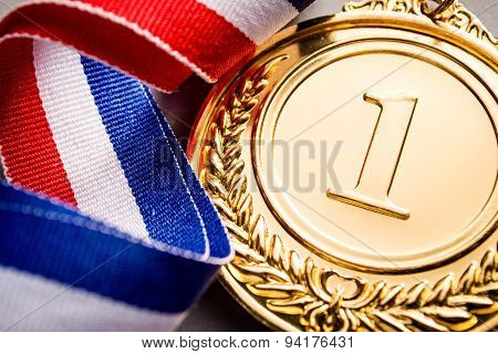 Gold Medal Winner At The Light Background