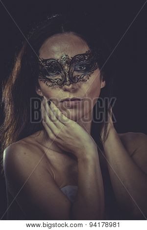 Skin, brunette woman in black mask metal frills