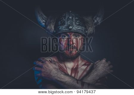 Fear, Viking warrior with a horned helmet and war paint on his face