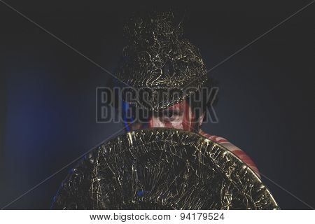 magician fighter with shield and helmet of gold and geometric shapes, fantasy
