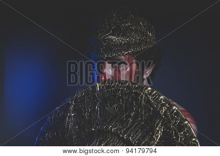 Medieval, bearded man warrior with metal helmet and shield, wild Viking