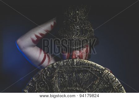 Soldier, bearded man warrior with metal helmet and shield, wild Viking