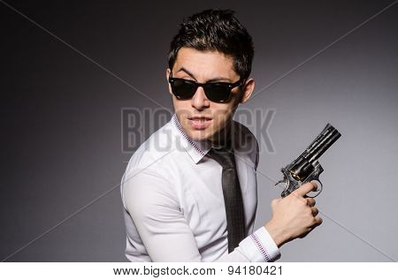 Young man in cool sunglasses isolated on gray