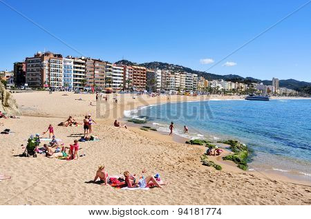 LLORET DE MAR, SPAIN - MAY 22: Sunbathers at Platja de Lloret beach on May 22, 2015 in Lloret de Mar, Spain. It is the main beach in this popular tourist village in the Costa Brava, in Catalonia