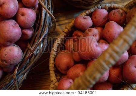 Red New Potatoes In A Baskets On Table