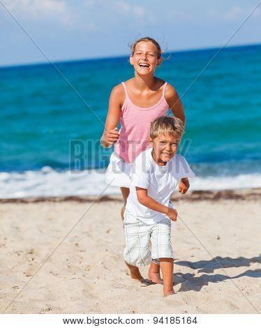 Kids play on the beach