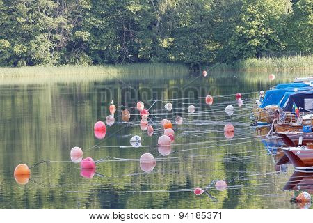 Lots Of Buoys And Boats