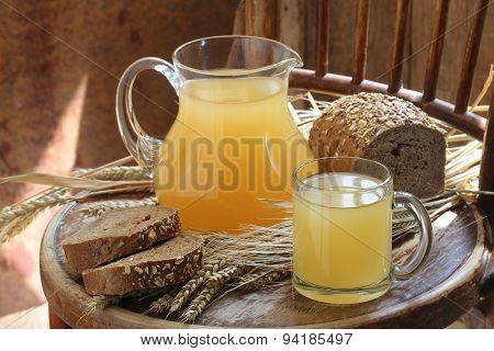 Kvass (kvas) In A Transparent Jug And Rye Bread
