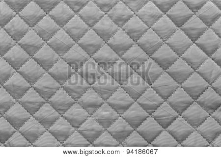 Gray Quilted Synthetic Fabric With Grained Texture