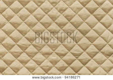 Golden Quilted Fabric With Grained Texture