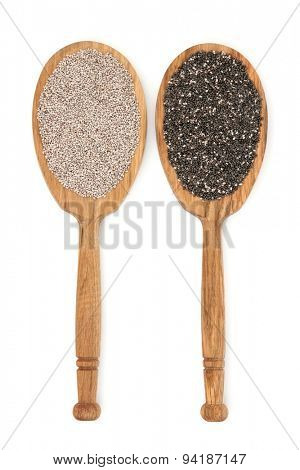 Chia seed in oak wood spoons over white background. Salvia Hispanica.
