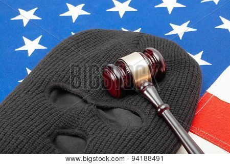 Thief Mask With Judge Gavel Over Us Flag - Studio Shot