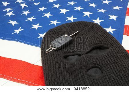 Thief Mask With Car Keys Over Us Flag