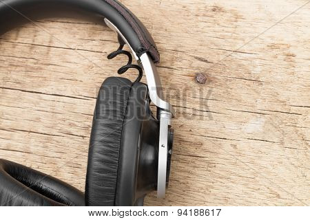 Vintage Headphones On Wooden Table - Retro Music Concept