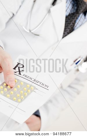 Medical Doctor Handing Out Drug Prescription And Pills - Studio Shot