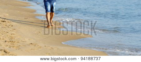 Man Walking On Sand Beach