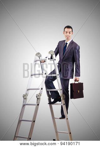 Businessman climbing career ladder against gradient