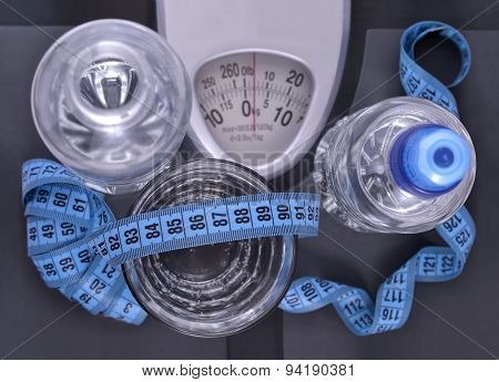 Bottles Of Water, Glass Of Water And Measuring Tape