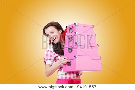 Young woman with storage boxes against the gradient