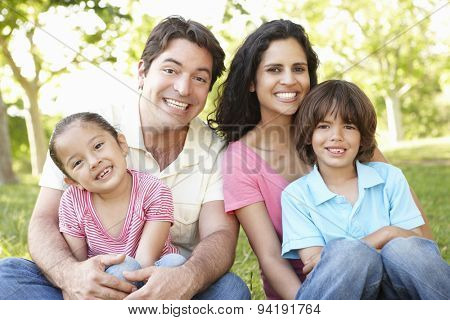 Young Hispanic Family Relaxing In Park