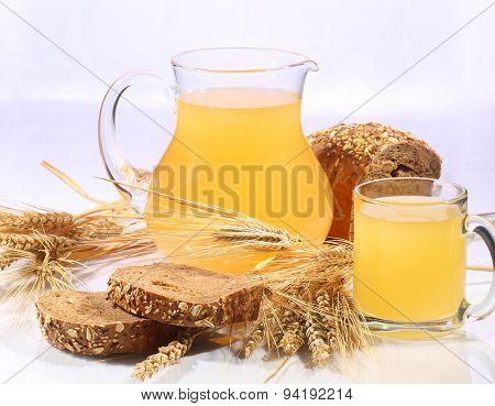 Kvass (kvas) In A Transparent Mug, A Jug And Rye Bread On A White Background