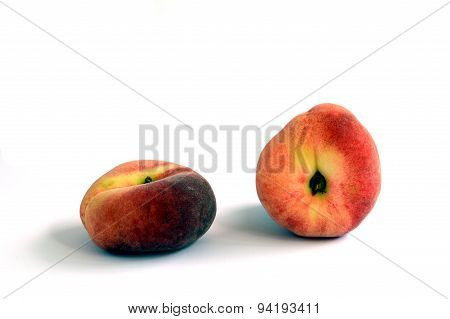 Two Donut/Flat Peaches Against White Background