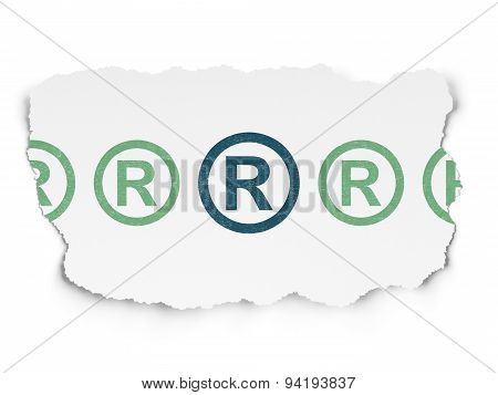 Law concept: registered icon on Torn Paper background