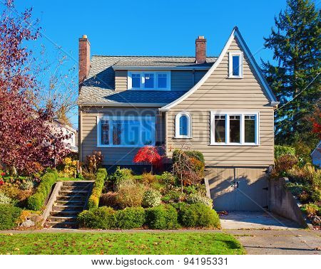 Large Traditional House With Shrubbery.