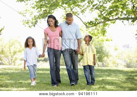 Young African American Family Enjoying Walk In Park