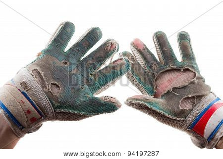 Old Torn Gloves and Hands of the Soccer Goalkeeper Isolated on White Background