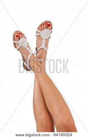 Perfect female legs with summer sandals, isolated on white background