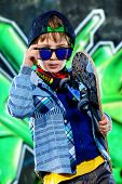 image of 7-year-old  - Cool 7 year old boy with his skateboard on the street - JPG
