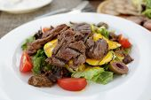 stock photo of veal  - Salad with grilled veal and vegetables on the white plate - JPG