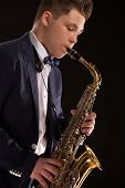 foto of saxophone player  - Talented saxophonist playing saxophone player in studio silhouette - JPG
