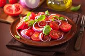 stock photo of vinegar  - healthy tomato salad with onion basil olive oil and balsamic vinegar - JPG