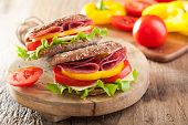 foto of tomato sandwich  - healthy sandwich with salami tomato pepper and lettuce - JPG